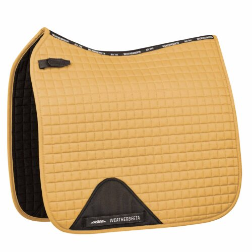 The WeatherBeeta Prime Dressage Saddle Pad is a durable cotton pad with a wick easy lining and breathable mesh spine to help keep your horse cool dry and comfortable